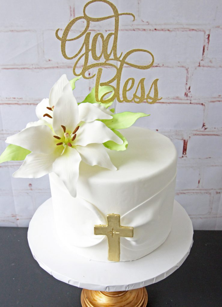 white fondant cake with edible flowers for christening, first communion, or baptisms
