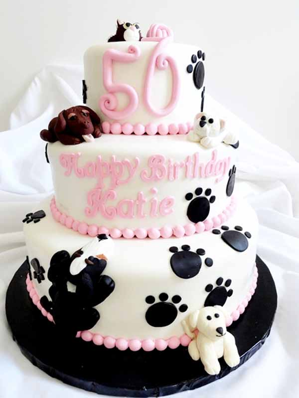 tiered cake puppies and paw prints