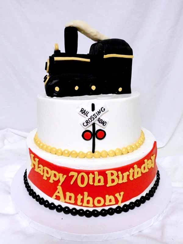 tiered cake with train