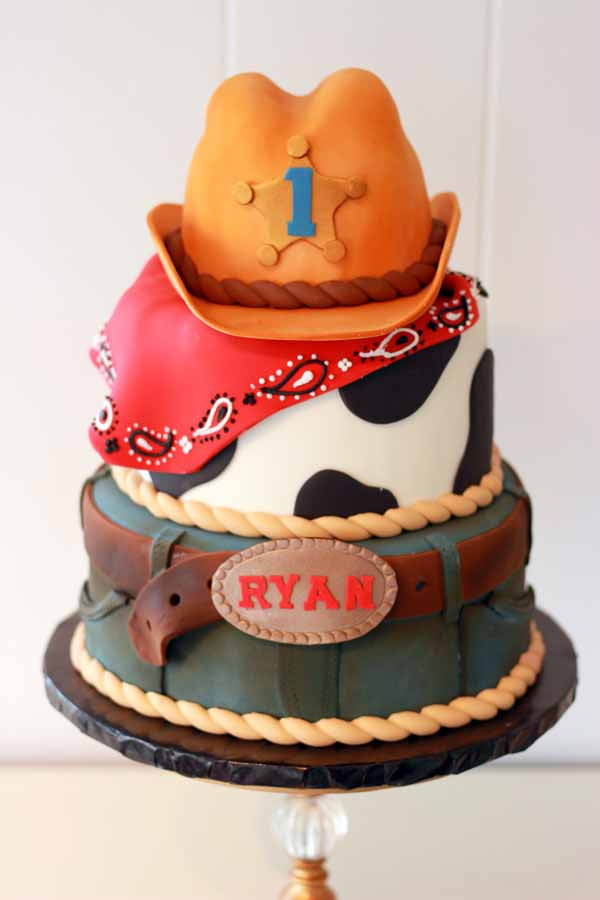 fondant cowboy birthday cake with sheriff's hat