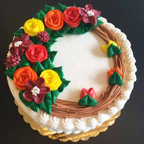 fall wreath buttercream flowers round cake