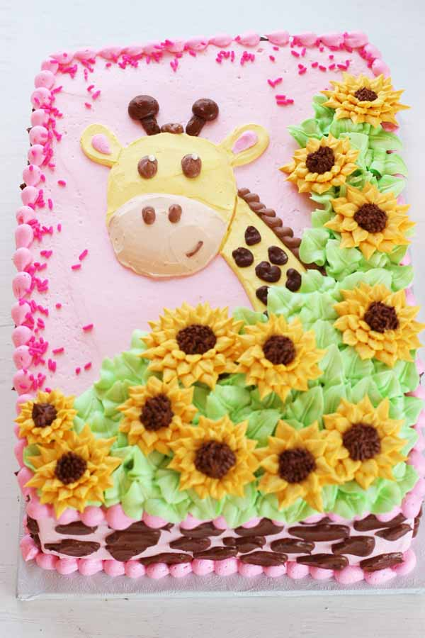 buttercream giraffe and sunflower sheet cake