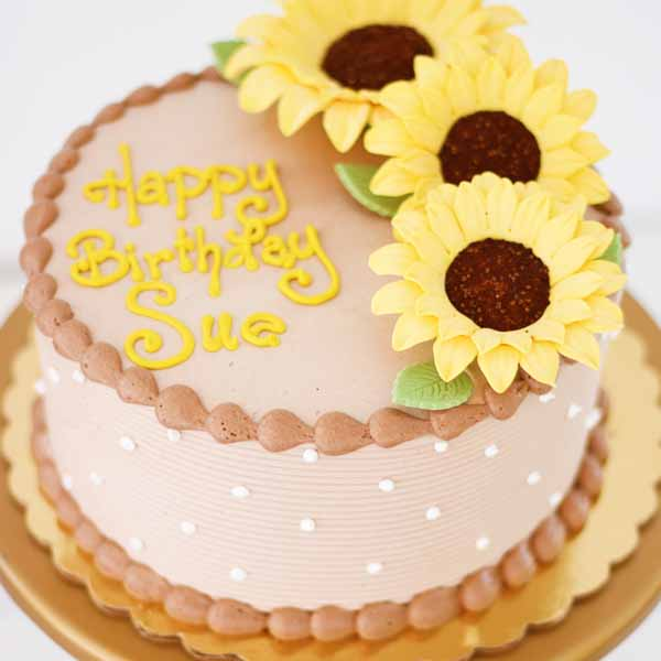 chocolate buttercream gumpaste sunflowers round cake
