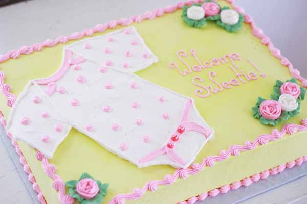 buttercream onesie baby shower cake
