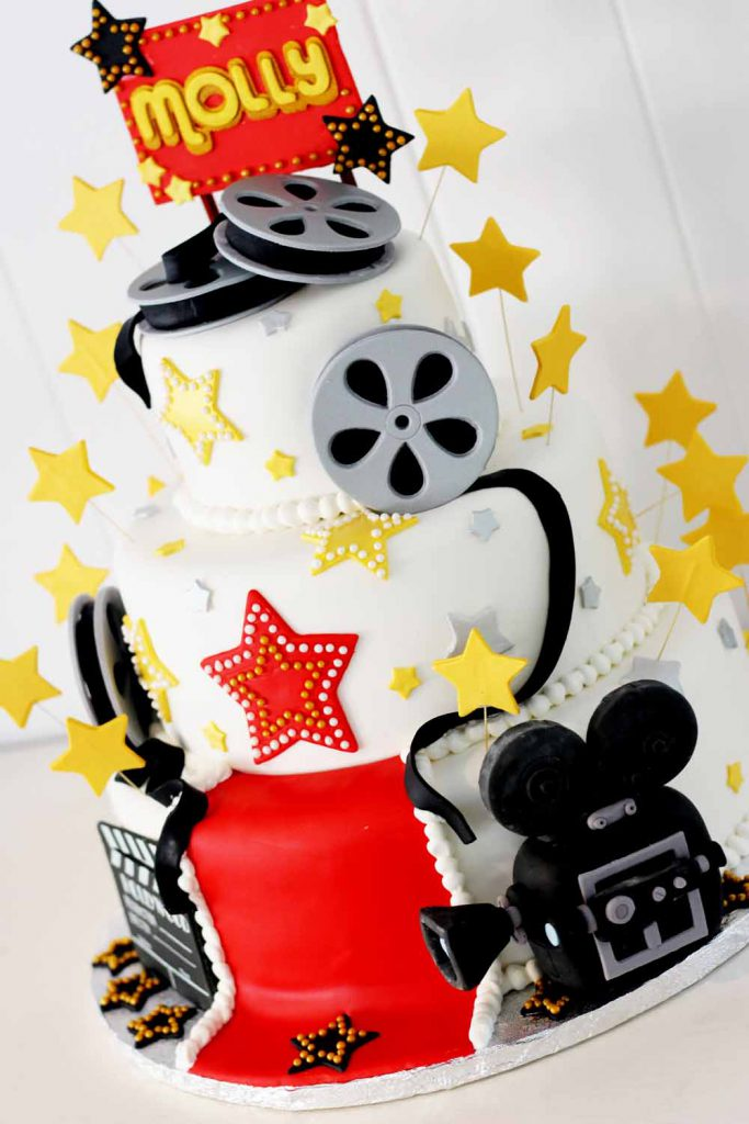 movie themed red carpet cake with stars for sweet sixteen