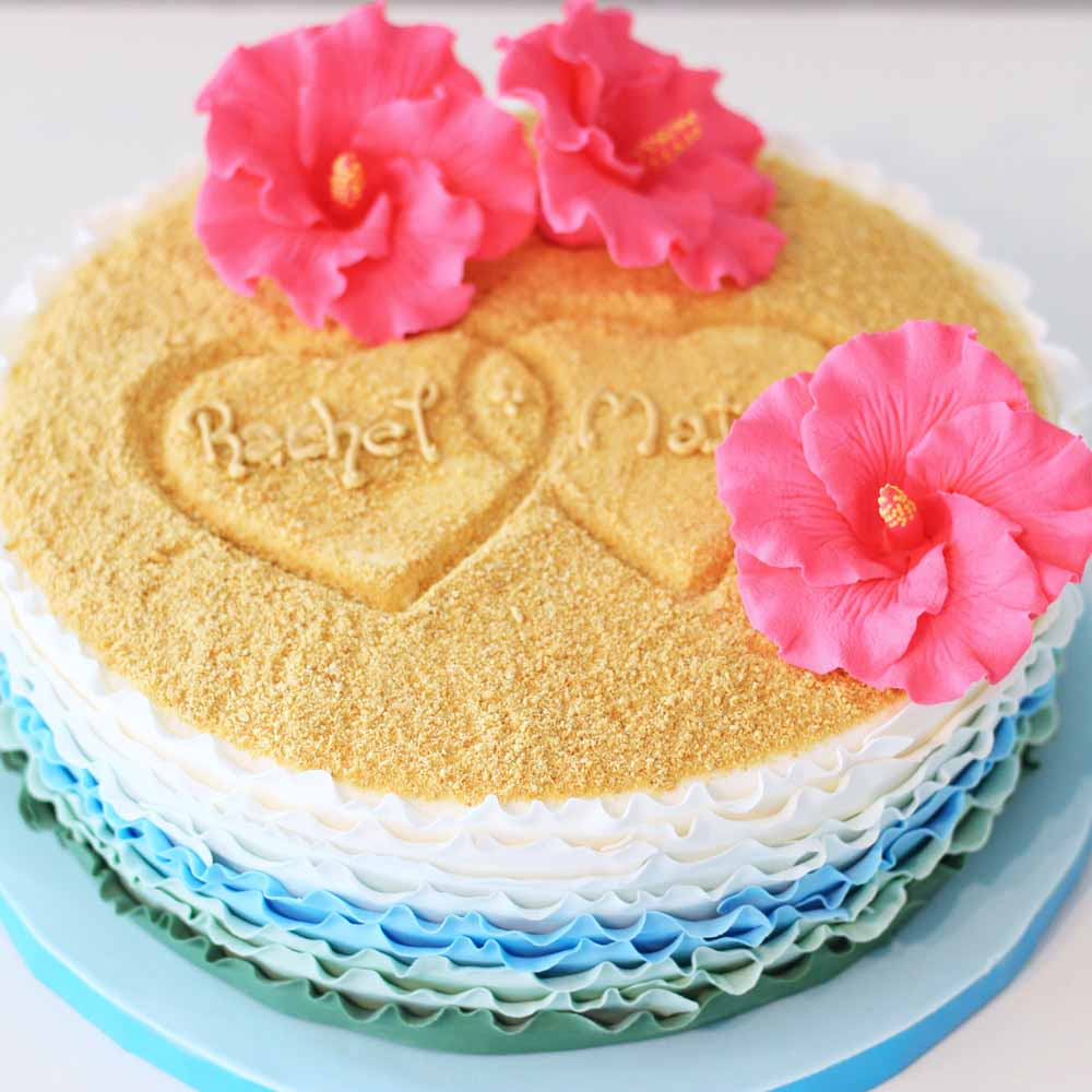 hearts in sand bridal shower cake with hibiscus flowers and fondant ruffles
