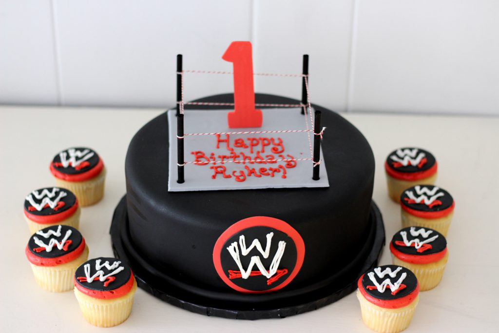 wrestlemania themed cake and cupcakes with wrestling ring for first birthday