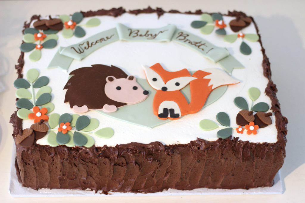 woodland creature cake with fox, hedgehog and acorns