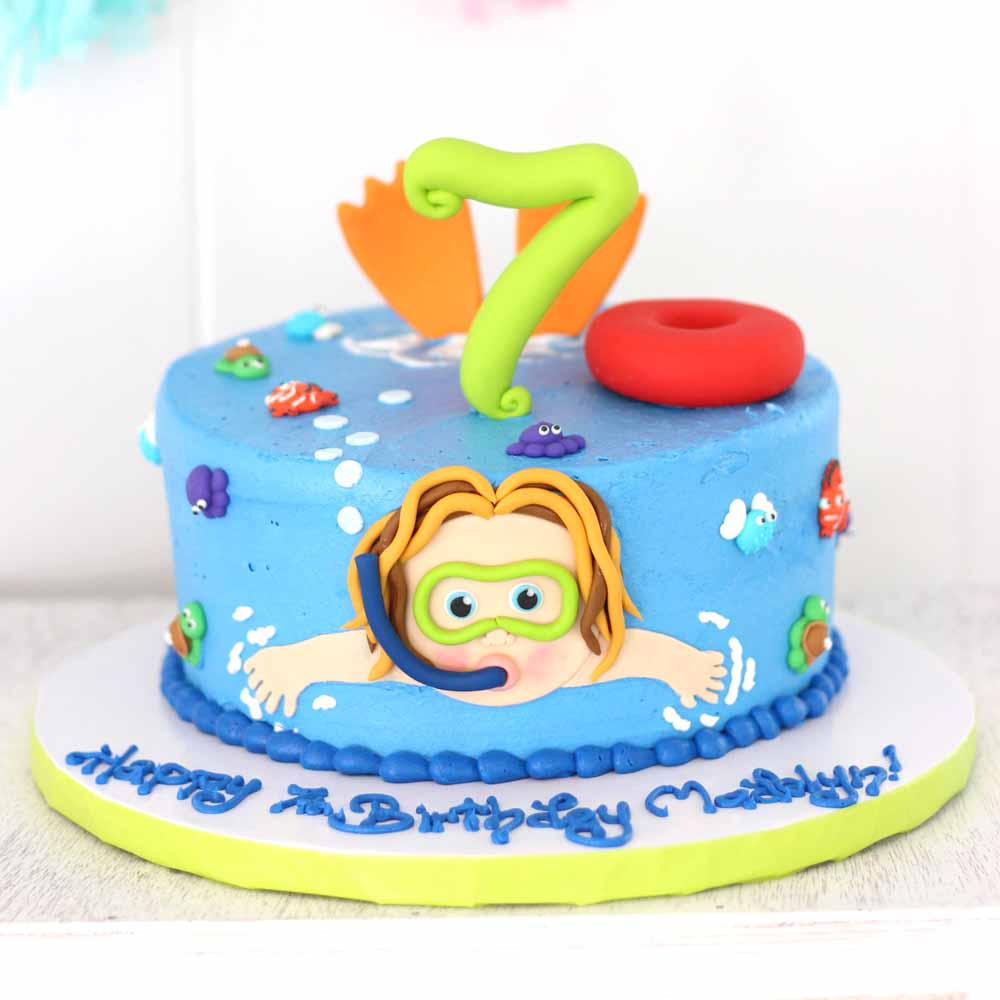 fondant scuba swimmer birthday cake with fish and inner tube