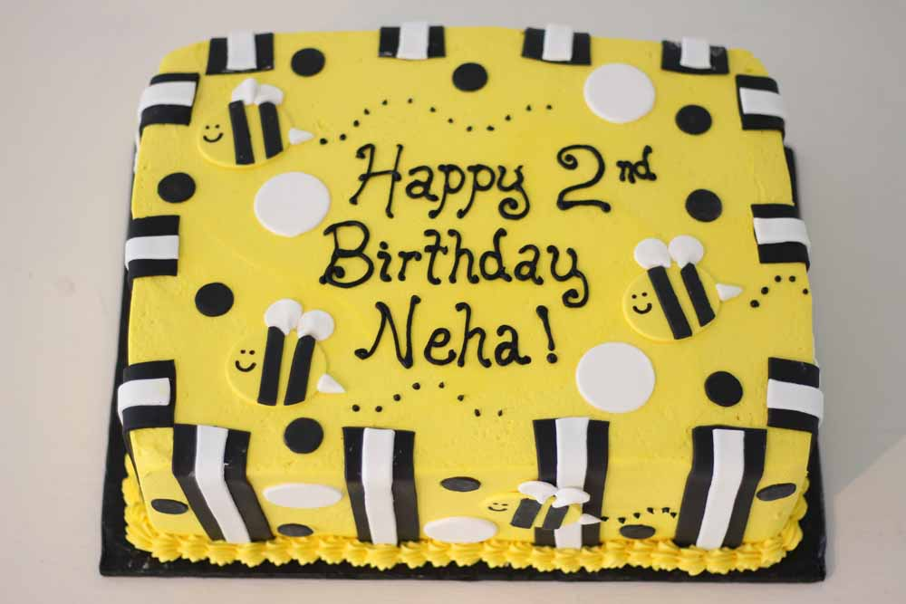 bumble bee, polka dots, stripes birthday cake