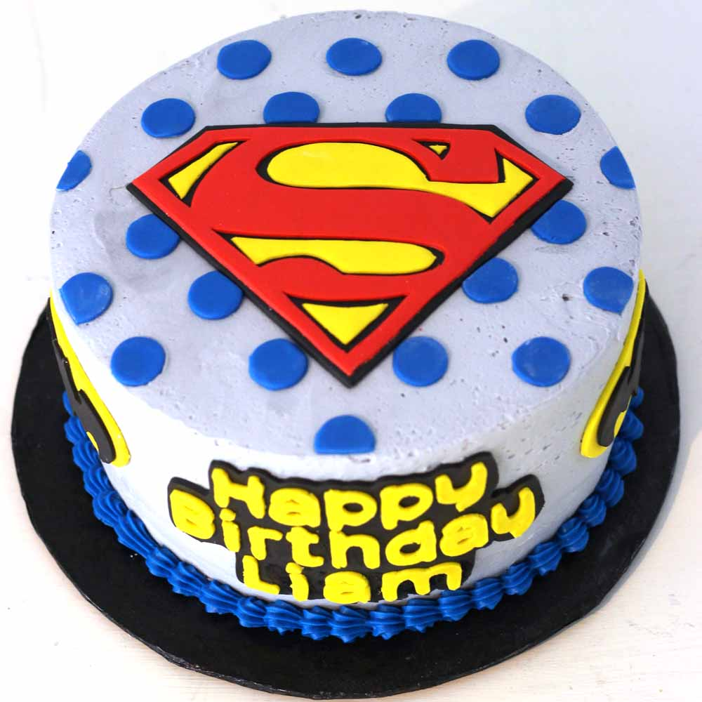 Superman vs Batman sheet cake with fondant symbols and lettering