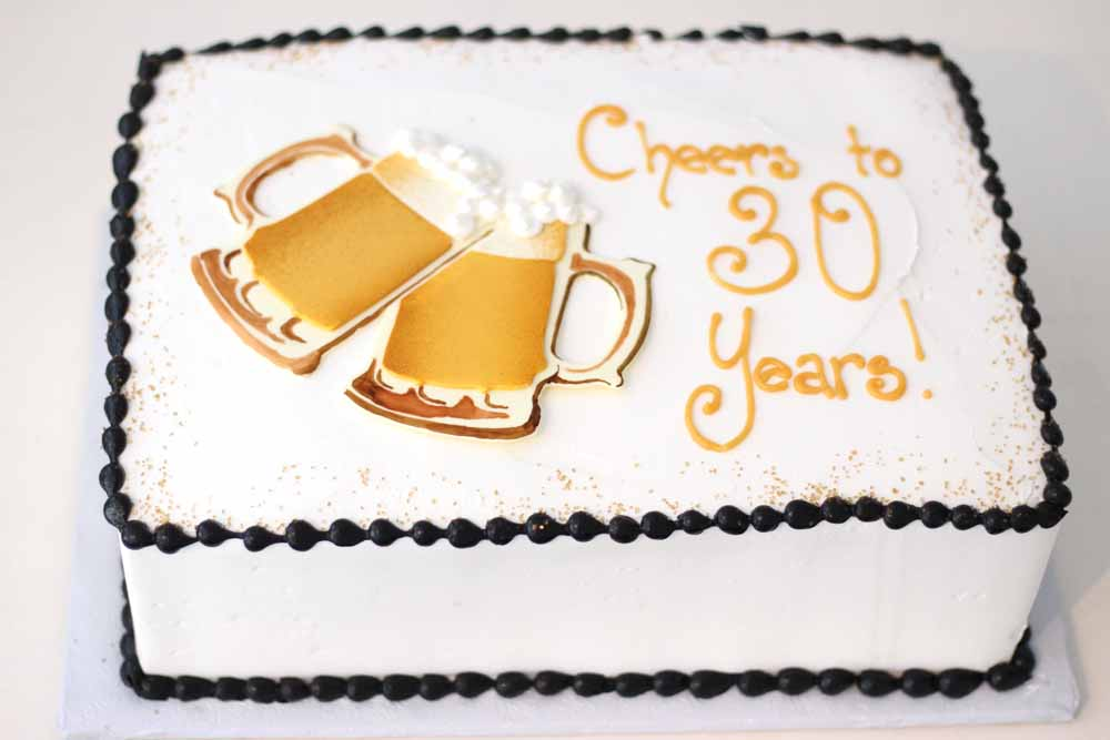 buttercream sheet cake with beer stein shapes