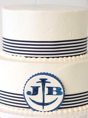 nautical themed ribbon and monogram wedding cake